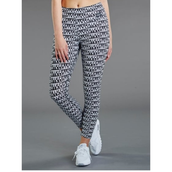 factory price 4e4e9 6406e Nike Sportswear Leg-A-See Allover Print Leggings. M 5b5a9fa13c9844f7c41f9bd5